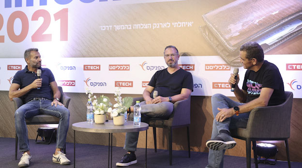 TripActions founders Ilan Twig (left) and Ariel Cohen speaking with Meir Orbach at Calcalist's FinTech 2021 conference Photo: Yariv Katz