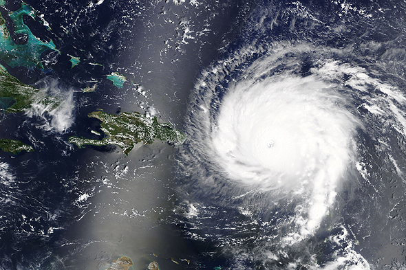 Hurricane Irma severely damaged orange groves, driving up the cost of orange juice. Photo: NASA via Shutterstock