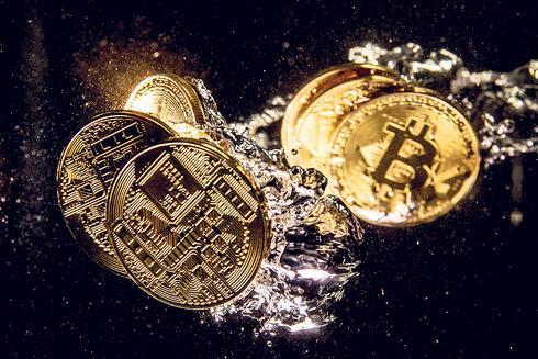 מטבעות ביטקוין, צילום: Dan Kitwood