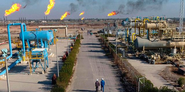שדה נפט בדרום עיראק שבו פעילה אקסון מוביל, צילום: איי פי