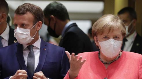 קאנצלרית גרמניה אנגלה מרקל ונשיא צרפת עמנואל מקרון, צילום: אי פי איי