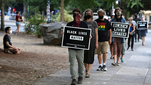 """מתוך מחאה בארה""""ב נגד גזענות לאחר רצח ג"""