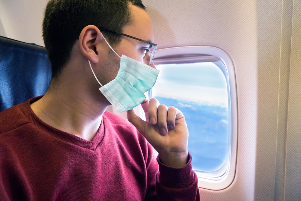 מטוס נוסע מסכה קורונה וירוס