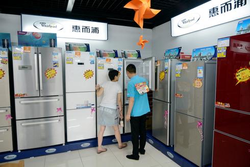 מקררים של חברת ווירפול האמריקאית בדליאן סין, צילום: איי אף פי