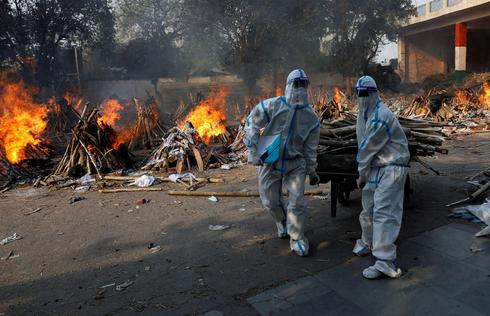 שריפת גופות בהודו, צילום: רויטרס