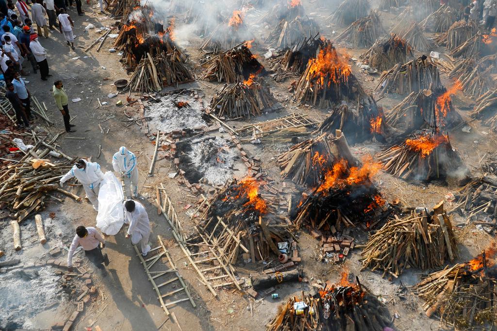 מוסף שבועי 29.4.21 שרפה המונית של גופות נספים מ קורונה השבוע ב דלהי הודו