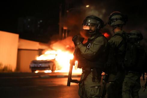 המהומות בלוד, צילום: רויטרס