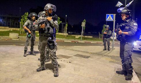 כוחות ביטחון בלוד, אמש, AFP