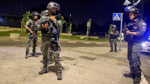 כוחות ביטחון בלוד, הלילה, AFP