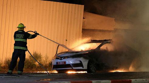 מכבים מכונית משטרה שנשרפה בלוד, רויטרס