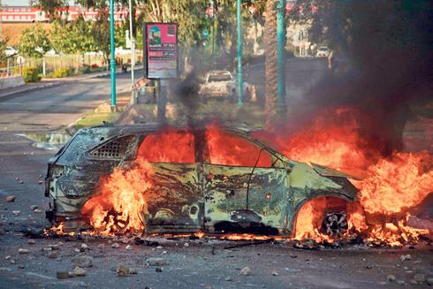 המהומות בלוד בשבוע האחרון, צילום: איי אף פי