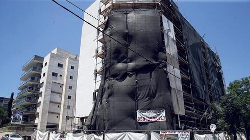 """בניין שעובר תמ""""א 38 ברעננה, צילום: אוראל כהן"""