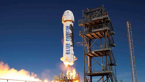 מרחף מעל כולם: ג'ף בזוס יצטרף לשיגור הראשון של בלו אוריג'ין לחלל