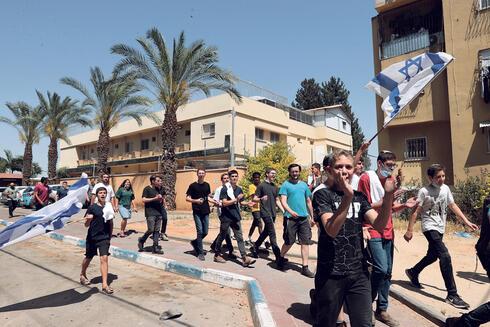 יהודים מתפרעים בלוד, צילום: אוראל כהן