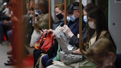 נוסעם ברכבת התחתית במוסקבה, צילום: AP