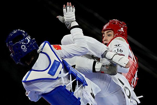 קימיה עליזאדה, לוחמת טאקוונדו, אולימפיאדת טוקיו 2020 , Javier SORIANO, AFP
