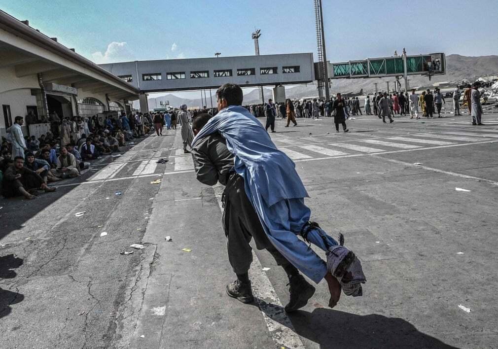 פוטו אפגניסטן טאליבן פצוע שדה תעופה