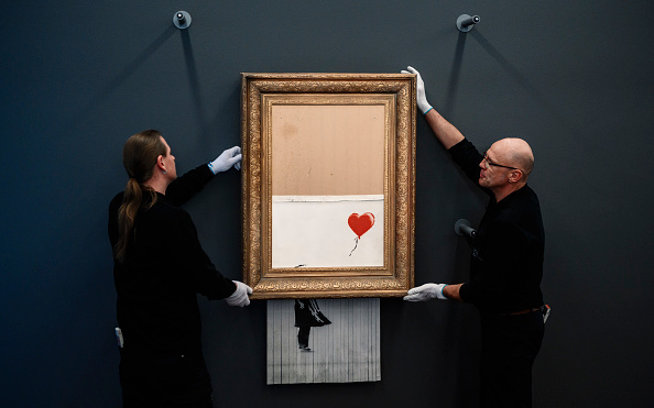 Banksy created a girl with a shredded balloon and her name changed to Love in the Trash Can is again offered for sale