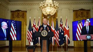 """נשיא ארה""""ב ג'ו ביידן ראש ממשלת בריטניה בוריס ג'ונסון וראש ממשלת אוסטרליה סקוט מוריסון מכריזים על ברית ביטחונית חדשה , AP"""