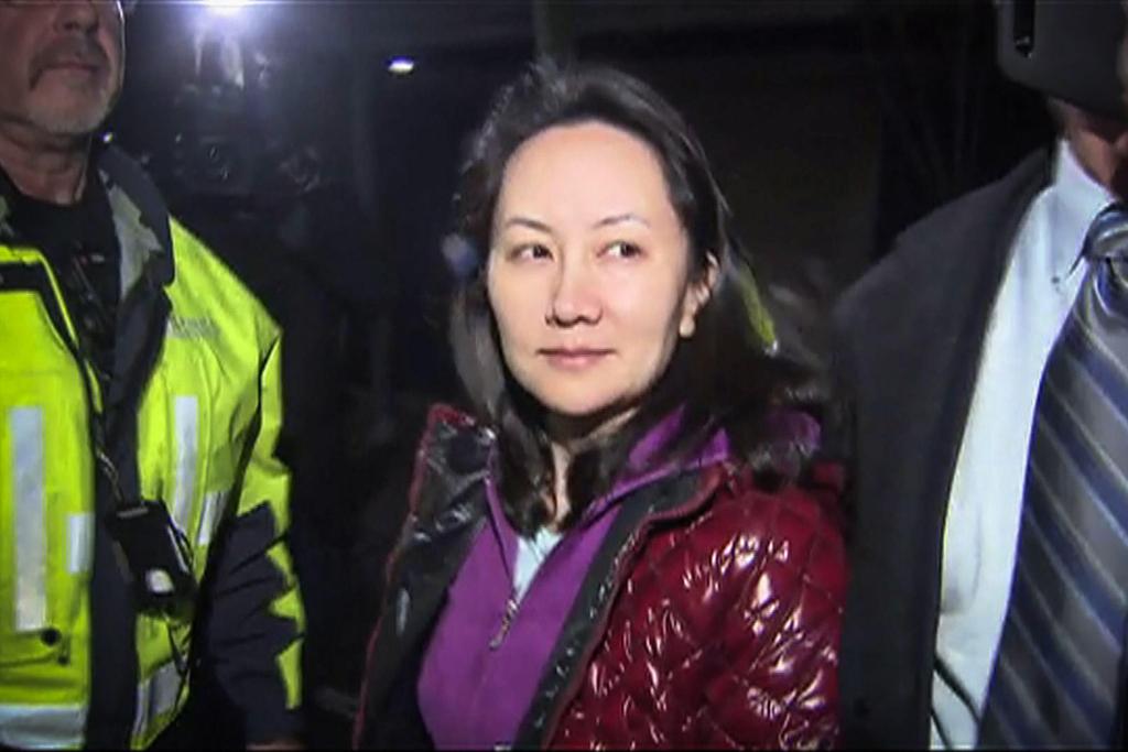 מנג וואנז'ו לאחר שחרורה בערבות בקנדה